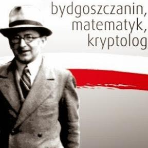 Marian Rejewski na tle barw narodowych i napisu: bydgoszczanin, matematyk, kryptolog.