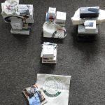 Nagrody w postaci głośników blutooth, kubków, smyczy, toreb z logotypami biblioteki
